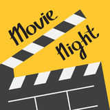 Big open clapper board. Movie night text. Lettering. Flat design style. Yellow background. Royalty Free Stock Photo