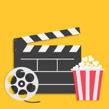 Big open clapper board Movie reel Popcorn Cinema icon set. Flat design style. Yellow background. Vector illustration Stock Photo