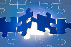 The big opportunities. Dark blue puzzles. It is a metaphor (the beginning; opening; end Royalty Free Stock Photography