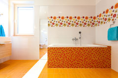 Big orange bath in cute contemporary bathroom Stock Photography