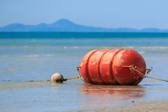 Big orange buoy Stock Image