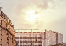 Big orange cloudy sky with old building in city center Royalty Free Stock Photo