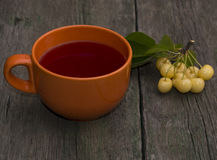 Big orange mug of juice and berry of white sweet cherry Royalty Free Stock Photo