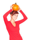 Big orange pumpkin with smiling girl Royalty Free Stock Photos
