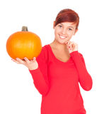 Big orange pumpkin with smiling girl Stock Photo