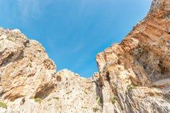 A big orange rocks on background of blue sky. Agio Farango beach. Crete stock image