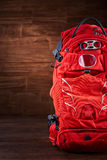 Big orange tourist backpack on the wooden background. Stock Photography