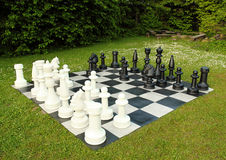 Big outdoor chess in green lawn. In sunny day Stock Photo