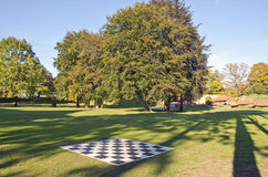 Big outdoor empty chess board in autumn park. Big outdoor empty chess board in autumn manor park Stock Photography