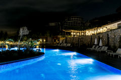 Big Outdoor hotel pool by night Royalty Free Stock Image