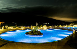 Big Outdoor hotel pool by night Royalty Free Stock Images
