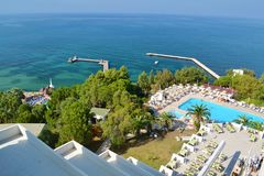 Big Outdoor Luxury Pool Area in a Big Hotel. Bodum ,TURKEY-15.07.17-Big Outdoor blue pool with palms,sunbeds and umbrellas royalty free stock image