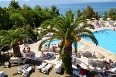 Big Outdoor Luxury Pool Area in a Big Hotel. Bodum ,TURKEY-15.07.17-Big Outdoor blue pool with palms,sunbeds and umbrellas stock photography