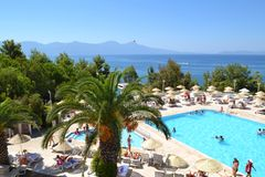 Big Outdoor Luxury Pool Area in a Big Hotel. Bodum ,TURKEY-15.07.17-Big Outdoor blue pool with palms,sunbeds and umbrellas royalty free stock photo