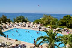 Big Outdoor Luxury Pool Area in a Big Hotel. Bodum ,TURKEY-15.07.17-Big Outdoor blue pool with palms,sunbeds and umbrellas stock photos