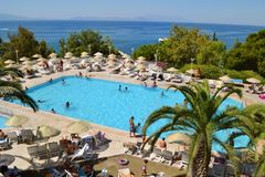 Big Outdoor Luxury Pool Area in a Big Hotel. Bodum ,TURKEY-15.07.17-Big Outdoor blue pool with palms,sunbeds and umbrellas royalty free stock photos