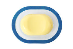 Big oval yellow soap isolated on white background. Lying on blue soap plate Stock Photos