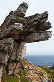 Big overhanging rock near the ocean Stock Photos