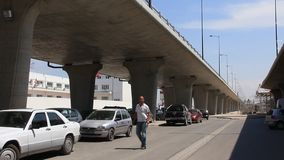 Big overpass in Tunisia. TUNISIA, TUNIS, JULY 9, 2010: Big overpass. Man get on a white car in Tunis, Tunisia, July 9, 2010 stock footage