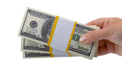Big packs of dollars in hand Stock Images