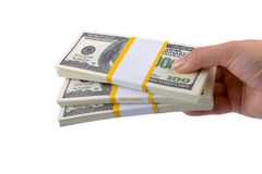 Big packs of dollars in hand Royalty Free Stock Photo