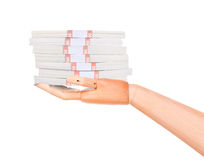 Big packs of dollars in wooden hand isolated Royalty Free Stock Image