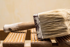 Big paintbrush over ladder Stock Photo