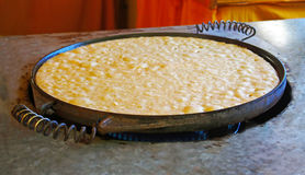 Big pancake on a frying pan. Spain Stock Photo