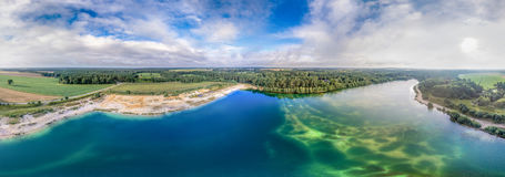 Big panorama from aerial pictures of a big lake after a gravel dismantling. Panorama from aerial pictures of a big lake after a gravel dismantling, drone Stock Photo