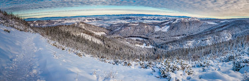 Big panorama of dawn over the mountain valley in winter Royalty Free Stock Images