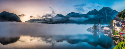Big panorama of foggy Hallstatt in autumn at dawn Stock Photography