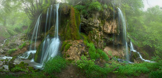 Big panorama of foggy Sopotnica waterfalls. Panorama of beautiful waterfalls and cascades in woods at misty morning. Travel destination Sopotnica, Serbia Stock Images