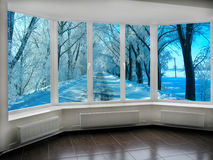 Big panoramic windows with view to winter fabulous road. Big office panoramic windows with view to birch grove in May royalty free stock photo