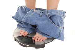 Big pants down on scales Stock Photography