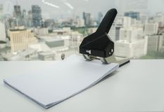 Big paper punch with A4 business sheet for file in office. Close up big paper punch with A4 business sheet for file in office royalty free stock images