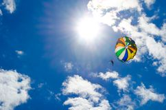 Big parachute in blue sky. Parachute sky clouds sun summer rest adrenalin Royalty Free Stock Image