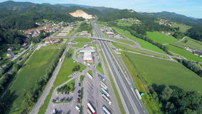 Big parking place near the gas station on a highway. Aerial slow motion fly over shoot of a big parking place near the gas station on a highway in a Slovenian stock video footage