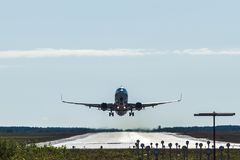 Big passenger airplane taking off and flying from an airport. stock photo