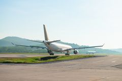 Big passenger airplanes on runway strip Stock Photo