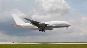 Big passenger jet landing. In an open field Stock Photos