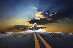 Big passenger plane flying over airport runway Royalty Free Stock Image