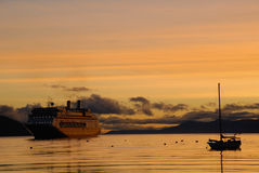 Big passenger ship and yacht at sunrise. Royalty Free Stock Photos