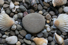 Big pebble on small rocks Royalty Free Stock Image