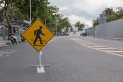 Big pedestrian crossing sign taken at parking lot.in thailand Royalty Free Stock Photos