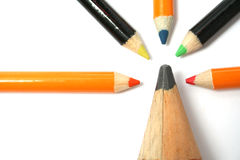 The big pencil and five small color pencils on a horizontal. 5 Royalty Free Stock Photo