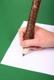 Big Pencil In Hand Royalty Free Stock Images