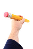 Big pencil in human hand Stock Photos