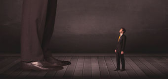 Big person with small businessman concept Royalty Free Stock Images