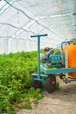 Big pesticide sprayer in greenhouse close up view. Big pesticide sprayer in greenhouse  close up view Royalty Free Stock Images