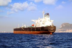 Big petrol tanker ALFA GERMANIA anchored. Petrol tanker vessel ALFA GERMANIA anchored in Algeciras Bay close to Gibraltar Rock in Cadiz stock photography